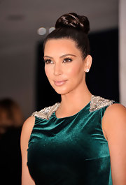 Kim Kardashian wore her hair up in a dramatic braided bun for the White House Correspondents' Association Dinner.