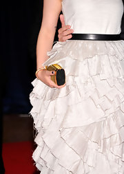 Ginnifer Goodwin carried this dainty gold clutch with her dramatic ruffled gown.