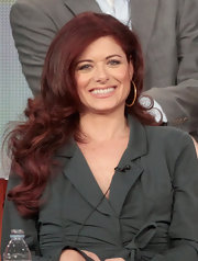Debra Messing wore her ultra-long hair in soft curls while attending the 2012 Winter TCA Tour.