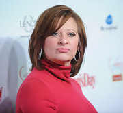 Caroline Manzo's layered cut gave her hair lots of volume.
