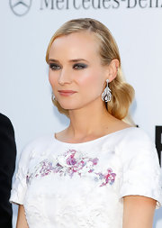Diane Kruger wore her hair in a sleek style featuring a deep side part and soft waves.