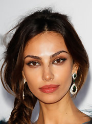 Madalina Ghenea opted for a pair of gemstone dangle earrings at amfAR event.