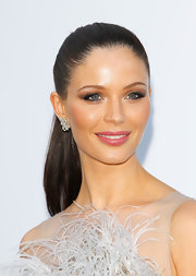 Georgina Chapman looked flawless wearing her long hair in simple sleek ponytail at the amfAR Cinema Against AIDS event.