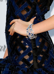 Kate accessorized her standout dress with this ringed bracelet.