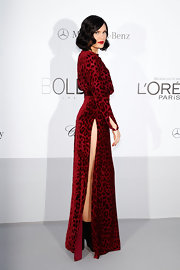 Apparently this velvet burnout dress with an up-to-there slit fulfilled Jessie J's skin-baring requirement at the amfAR benefit.