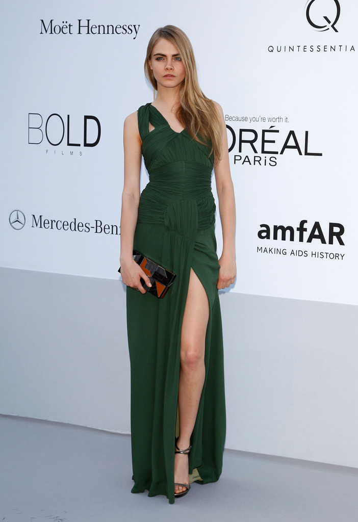 Model Cara Delevingne arrives at the 2012 amfAR's Cinema Against AIDS during the 65th Annual Cannes Film Festival at Hotel Du Cap on May 24, 2012 in Cap D'Antibes, France.