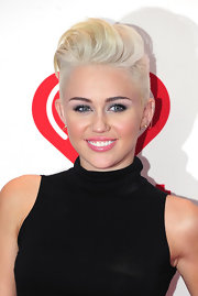 Miley's bleach blonde hair looked totally edgy and cool when styled into this pompadour-style 'do