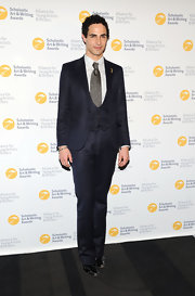 Zac Posen showed off his dapper style with this three-piece midnight blue suit.