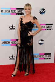 Heidi Klum completed her ultra-feminine look with a pair of black satin ankle-tie sandals by Brian Atwood.