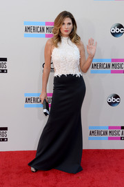 Daisy Fuentes looked svelte and elegant at the American Music Awards in a Tadashi Shoji evening dress featuring a white lace bodice and a black skirt.