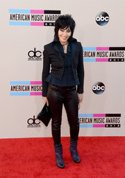 Joan Jett completed her rocker-chic ensemble with a pair of cap-toe ankle boots.