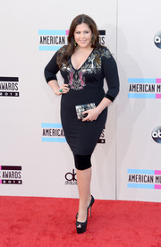 Hillary Scott teamed her dress with a sky-high pair of subtly sparkly black platform peep-toes.