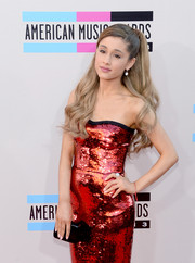 Ariana Grande complemented her glam dress with a small and simple black box clutch by Jimmy Choo when she attended the American Music Awards.