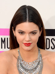 Kendall Jenner accentuated her pout with a gorgeous red lip color.