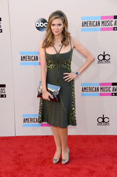 Carly Steel complemented her dress with a pewter envelope clutch for added shine.