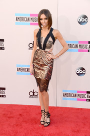 Giuliana Rancic went for modern elegance in a gold and black lace-overlay cocktail dress by Three Floor during the American Music Awards.