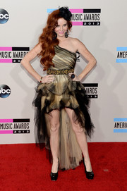 Phoebe Price chose a nude and black one-shoulder dress with a high-low hem for her American Music Awards red carpet look.