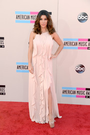 Adrianna Costa had a goddess aura about her in this ruffled white gown during the American Music Awards.