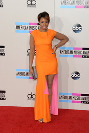 Jennifer Hudson was a style standout at the American Music Awards in a bright orange fishtail dress by Christian Dior.