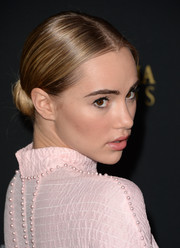 Suki Waterhouse slicked her hair back in a classic center-parted bun for the BAFTA LA Britannia Awards.