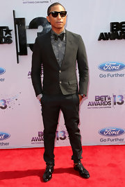 Pharrell Williams chose a classic black two-button suit with a bow tie for his red carpet look at the BET Awards.