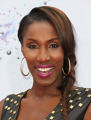 Lisa Leslie chose a side, fishtail braid to show off her chocolate locks.
