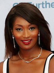 Toccara Jones chose a swipe of green shadow to put on her lower lids to bring out her deep brown eyes.