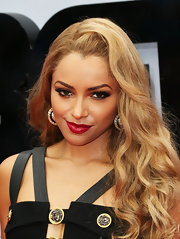 Kat topped off her retro-inspired look with a candy apple red lipstick.
