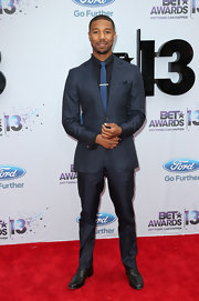 Michael B. Jordan looked dapper and stylish in this deep midnight blue two-piece suit.