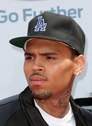 Chris Brown showed that his heart belonged to L.A by sporting a baseball cap with the city's name emblazoned on it.