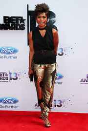 Angela Bassett opted for a sleeveless black top to pair with her metallic gold shimmery pants.