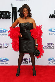 Margaret Avery chose this black strapless dress to pair with a bright red feather boa at the 2013 BET Awards.