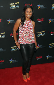 Laila Ali added some fun and flirty style to her black leather pants by pairing them with this patterned top.