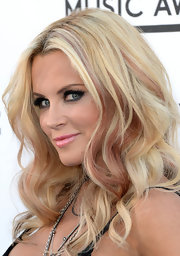 Jenny McCarthy balanced out her super dark smoky eye with a fun and flirty pink lip.