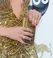 A deep red nail color complemented Jennifer Lopez's golden gown and clutch at the Billboard Music Awards.