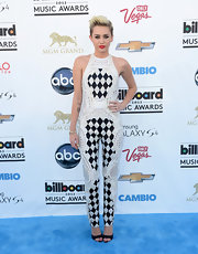 Miley's diamond checked crocheted jumpsuit mixed both classic and contemporary elements for a fun and unique look at the 2013 Billboard Music Awards.