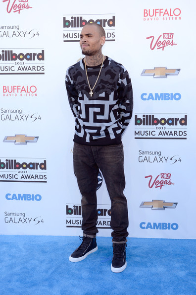 Chris Brown stuck to basic skinny jeans to complement his statement sweatshirt at the Billboard Music Awards.
