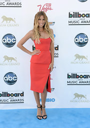 Renee Bargh chose a peach-colored classic column dress for her look at the 2013 Billboard Music Awards.