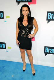 Kyle Richards' little black dress showed just a touch of skin with its cutout designs on the waist and bodice.