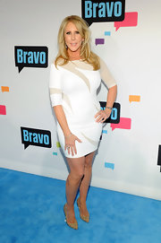Vicki Gunvalson kept her red carpet look simple and classy with this fitted white frock featuring nude swirl detailing.