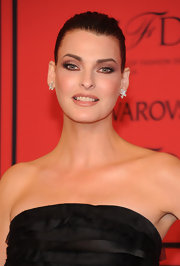 Linda Evangelista pulled back her hair into this tight updo to reveal her stunning makeup.