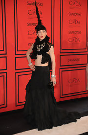 Michelle Harper chose an edgy black gown that featured a ruffled top and a draped tiered skirt.