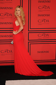 Ireland Baldwin stunned in a vibrant red custom draped jersey evening gown.