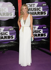 Sarah Darling chose this column-style white gown with a peek-a-book sequined bodice for her fun Grecian-inspired look at the CMT Music Awards.