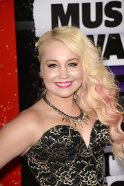 RaeLynn's platinum blonde waves showed off her pink streaks wonderfully with a deep side sweep.