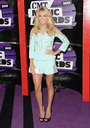 Carrie Underwood wore a soft aqua-colored short suit with geometric patterns and tulle inserts to the CMT Music Awards.