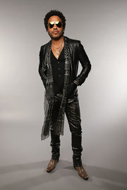 Lenny Kravitz rocked his signature rocker look with a black leather jacket and leather pants.