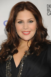 Hillary Scott's chestnut hair looked lovey styled into loose waves.