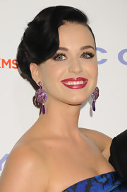 Katy Perry looked elegant and glamorous with her jet black hair pulled back into a classic chignon.