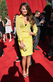 Chrissy went for a sunny yellow ensemble when she rocked this sheer blouse and matching pencil skirt.